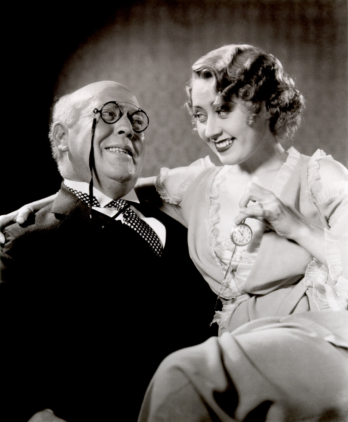 "Guy Kibbee, Joan Blondell:  'Every time you say ""cheap & vulgar,"" I'm gonna kiss you!' 'Cheap & vulgar! Cheap & vulgar!  Cheap & vulgar!'"
