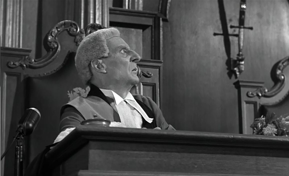 Francis Compton as the Judge