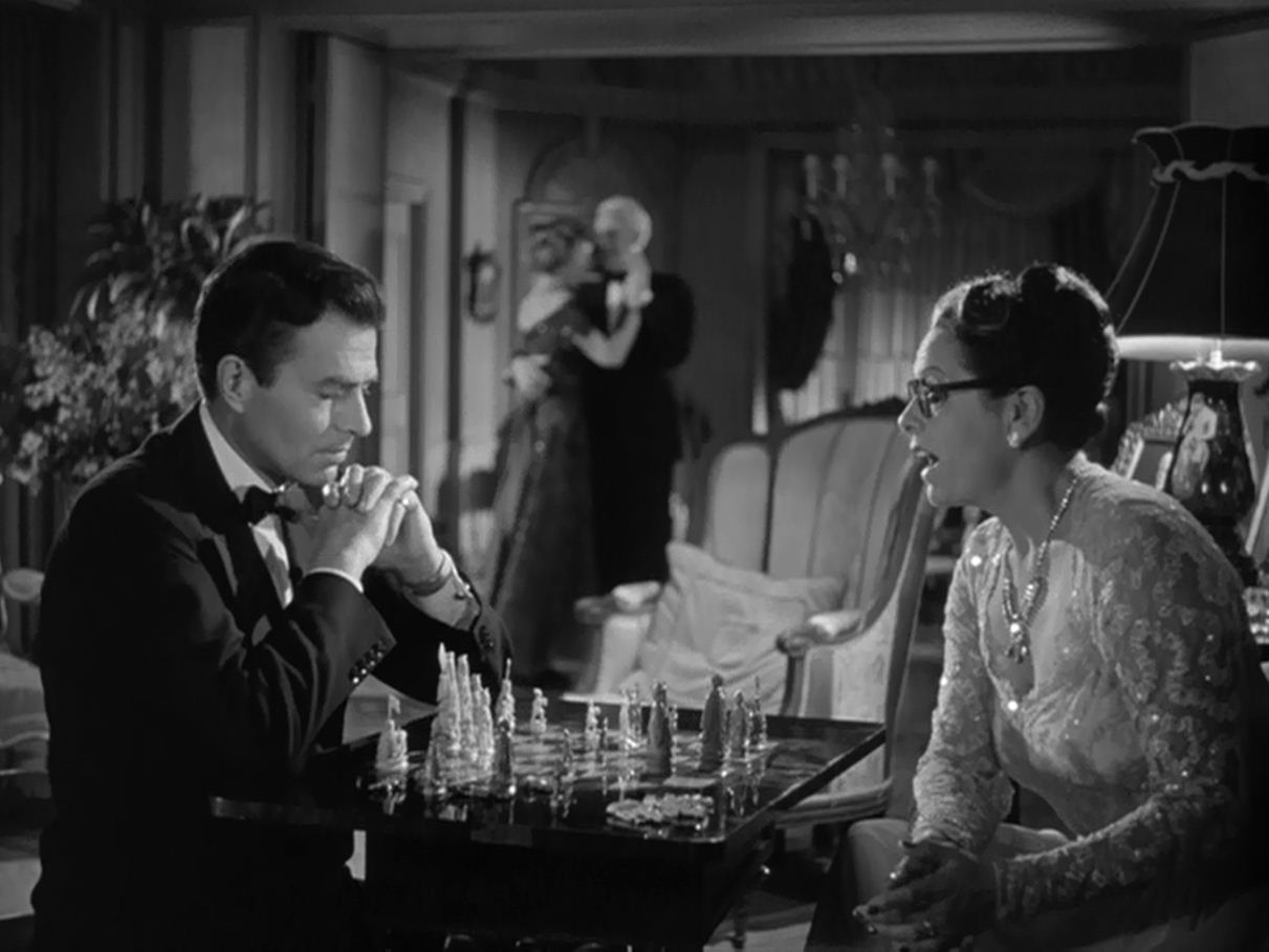 Brandon Bourne (James Mason) checks Nora Kernan (Gale Sondergaard).