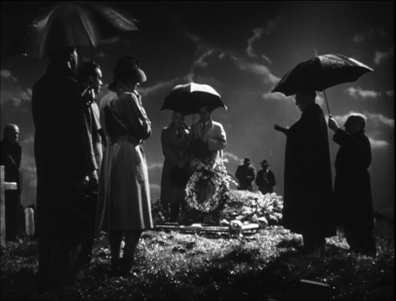 The Swede's funeral. I have a weakness for indoor rain scenes. Edmond O'Brien, Sam Levene and Virginia Christine are in the left foreground.
