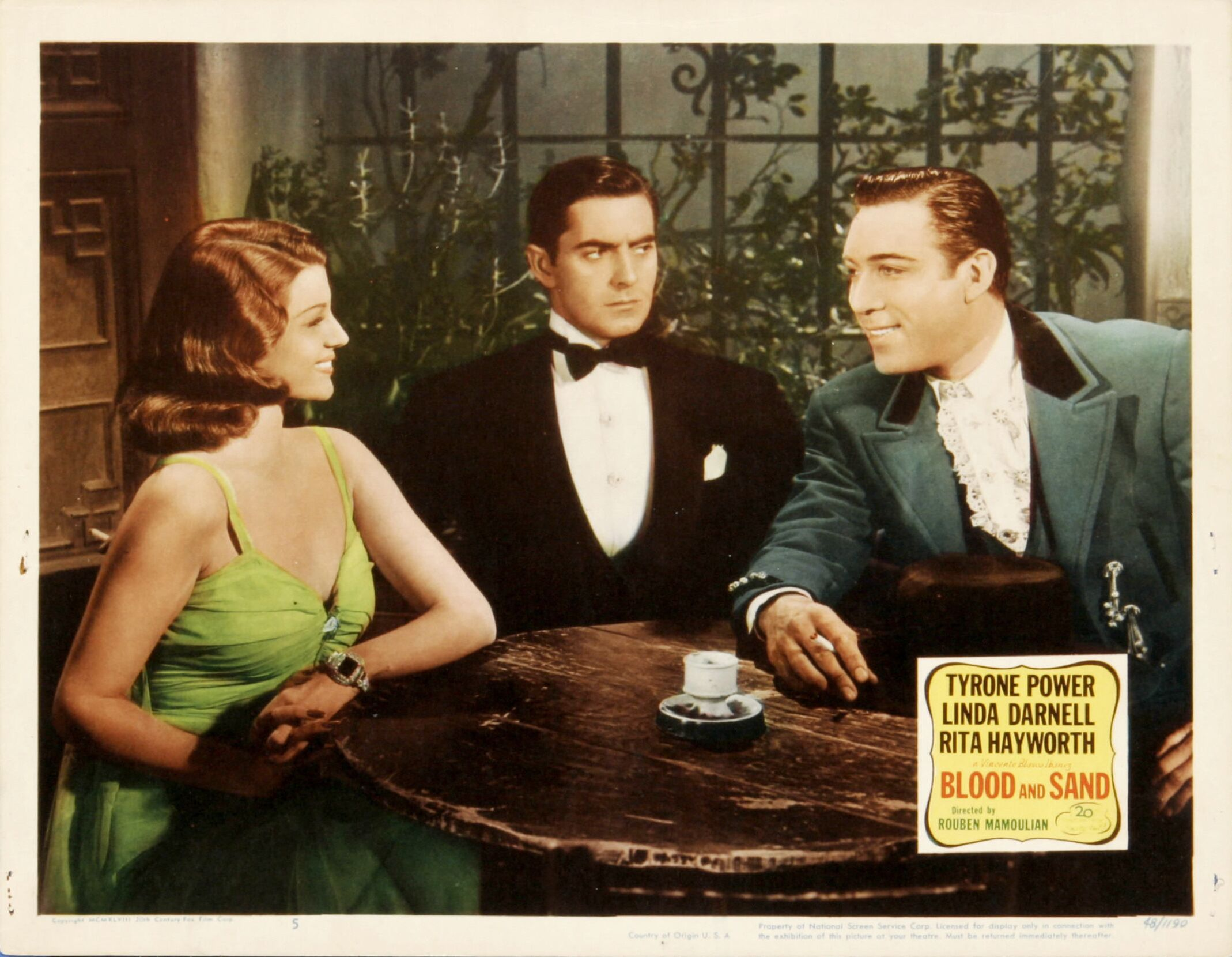 Rita Hayworth, Tyrone Power, Anthony Quinn: Two beauties, one beast.