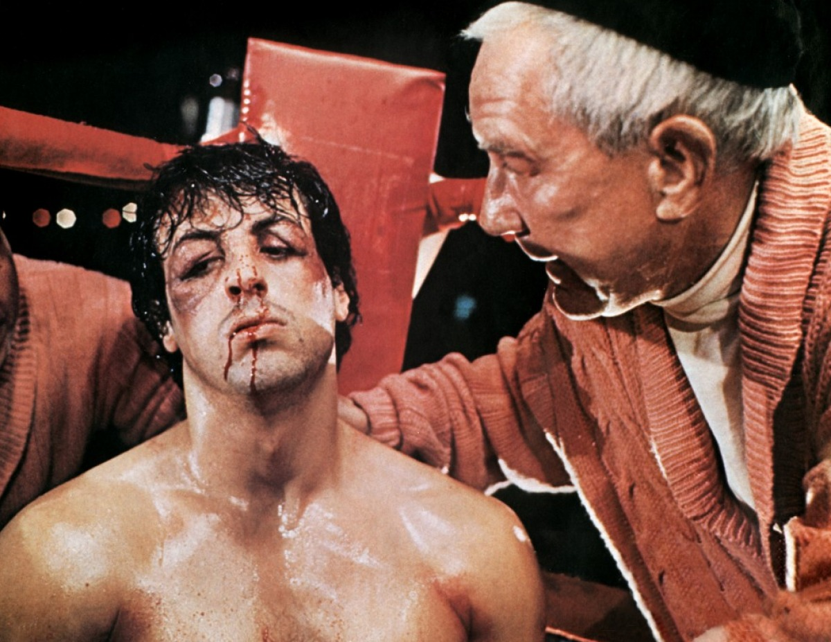 Sylvester Stallone, Burgess Meredith: Punchy gets boxing tips from the Penguin.