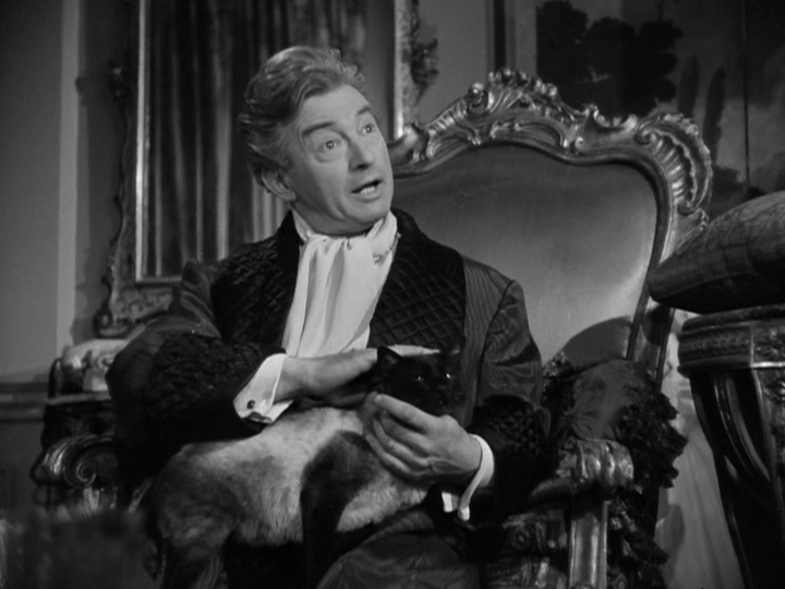 Claude Rains as Alexander Hollenius in 'Deception,' with friend.